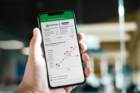 a person holds the TD Ameritrade app